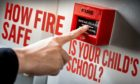A finger about to press a fire alarm with the text 'How fire safe is your school' beside it