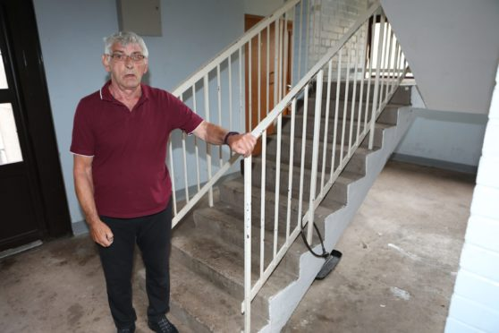 Gordon Archibald at the Forfar stairwell where a motorbike was padlocked. Pic: Gareth Jennings/DCT Media