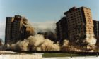 Going out with a bang: Ardler multis are demolished in 1996.