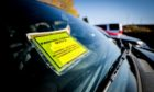A car with a penalty charge notice at Ninewells Hospital