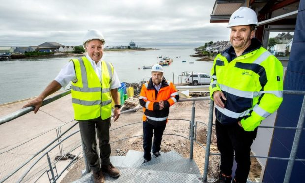Calum MacDougall, from Inland & Coastal Marine Systems, Captain Tom Hutchison, chief executive at Montrose Port Authority, and Sid Anverali, senior project manager for Seagreen.