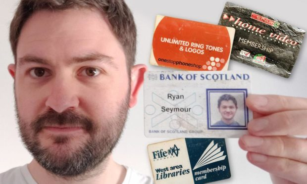 Ryan with some of the items in his wallet, which was stolen in 2004.