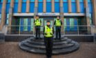 Officers outside Police Scotland Tayside Division HQ, West Bell Street, Dundee