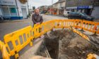 Courier News - Alasdair Clark story - CR0030300 -- roadworks on Cowdenbeath High Street unfinished leaving a large hole in road  -- Picture shows general view of the roadworks area and the hole with Councillor Darren Watt alongside --  193-195 High Street, Cowdenbeath -- Monday 23rd August 2021 --  Pic credit Steve MacDougall / DCT Media