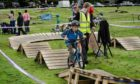 Staff at the Angus Cycle Hub work with young cyclists.