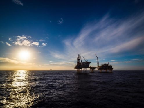 The sun sets over a  North sea oil platform. How long for the entire industry?