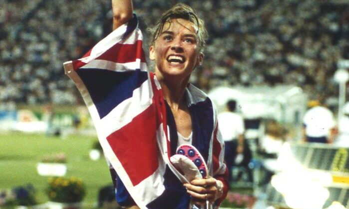 Liz McColgan waves to the crowd after winning gold in Tokyo.