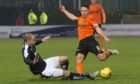 James McPake challenges John Rankin in the 2016 New Year's Dundee derby - the moment which ended his playing career.