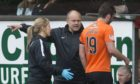 Mixu Paatelainen orders Gavin Gunning back on the field during the bizarre incident at Tannadice.