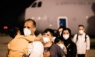 Afghan refugee families arrive at the Torrejón de Ardoz military base in Madrid in August 2021. Diego Radames/SOPA Images/Shutterstock