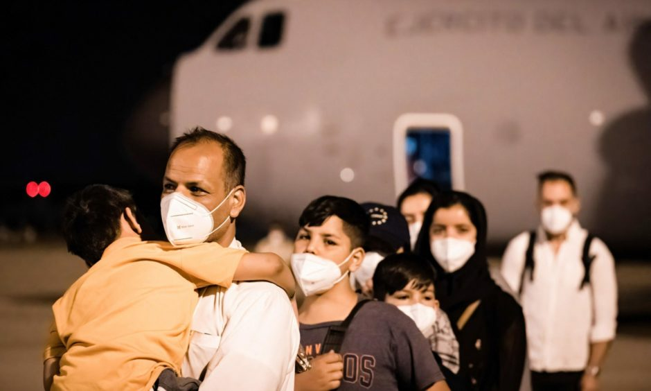 Afghan refugee families arrive at the Torrejón de Ardoz military base in Madrid in August