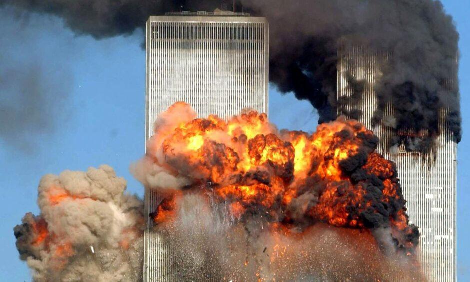 Hijacked United Airlines Flight 175 from Boston crashes into the south tower of the World Trade Center and explodes at 9:03 a.m. on September 11, 2001