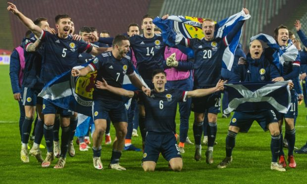 Scotland's players celebrate success in Serbia to qualify for Euro 2020 and end 22 years of hurt.