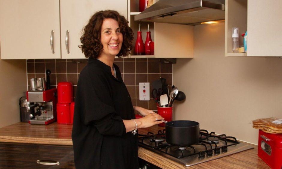 Debbie Hamilton in her kitchen.