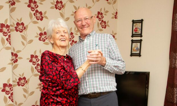 Alan and Irene Stewart had to settle for a birl around the living room on their diamond day. Pic Paul Reid.