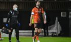 Charlie Mulgrew was forced off injured for Dundee United as they crashed to defeat against Hibernian