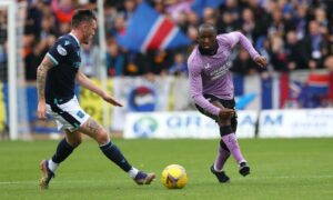 Rangers' Glen Kamara takes on Dundee's Jordan McGhee.