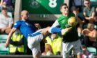 Hibs' Paul Hanlon and St Johnstone's Chris Kane in action.