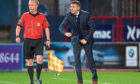 Dundee manager Jim McIntyre watches in frustration as his side are well-beaten by league leaders Hearts at Dens Park on Tuesday night.