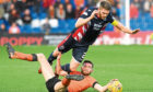 As Sam Stanton shows here, Dundee United needed to display total commitment to win in Dingwall.
