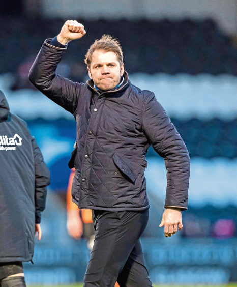 Dundee United manager Robbie Neilson celebrates at full time
