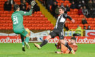 John Sutton has a late shot saved by Mehmet during a match for United against St Mirren.