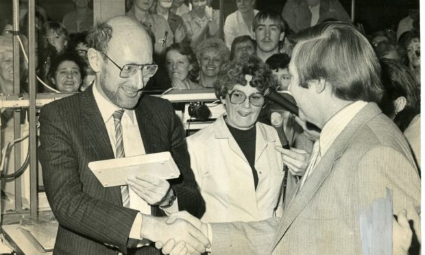 Sir Clive Sinclair receives a special model of the Spectrum micro-computer at Timex, Dundee, to mark the one-millionth version of the model.