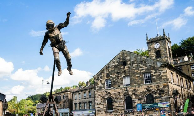 A performer from theatre company Highly Sprung Performance during their show Urban Astronaut in Holmfirth, West Yorkshire. Danny Lawson/PA Wire