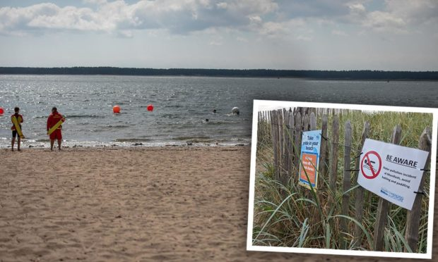 Signs at Broughty Ferry beach warned against swimming after the sewage leak.