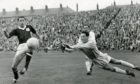United keeper Sandy Davie saves from Dundee's Alan Gilzean at a packed Tannadice (1962).