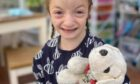Emily with her beloved soft toy 'Puppy'