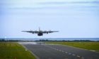 A Hercules aircraft leaves Leuchars Station on Tuesday afternoon.