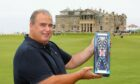 Giorgio Cozzolino at the Old Course showing off Old Tom Gin.