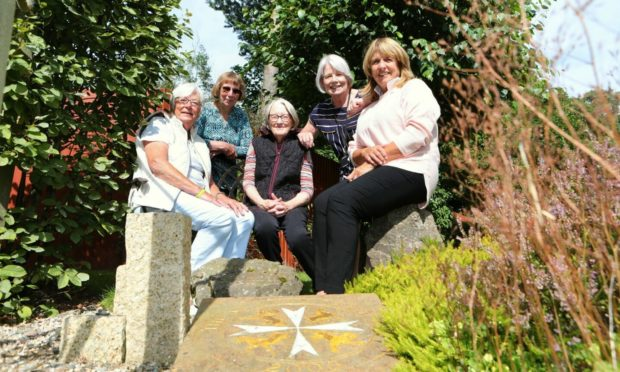 Lippen Care executive members (from left) Elma Walker, Pat Bright, Jean McEwen, Marion Hood (manager) and Moira Nicoll (chairperson) in the St John's Garden at the Strathmore Hospice. Pic: Gareth Jennings/DCT Media.