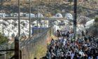 People gather at a temporary refugee camp in Kara Tepe. Lesbos in September 2020. (AP Photo/Panagiotis Balaskas)