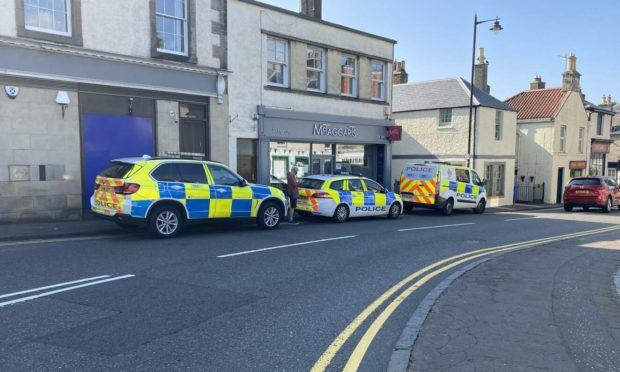 Police and ambulance vehicles in High Street Aberdour during the incident.