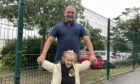 Dad Paul McDonald, 48, and daughter Evie McDonald, 3, outside Fintry Primary School.