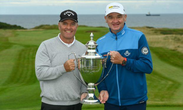 Paul Lawrie, right, with Scottish Senior Open champion Thomas Levet