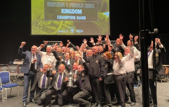 Band members celebrate as Kingdom Brass are crowned National Champions.