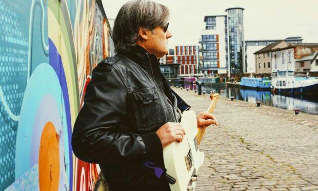 Dunfermline guitarist made good, Neil Warden.