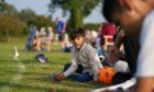 Recently arrived Afghan citizen Adbullah watches on from the boundary as his father takes part in a cricket match with members of Newport Pagnell Town Cricket Club in Buckinghamshire, organised by the club as a gesture to welcome them to the UK.  Picture by PA.