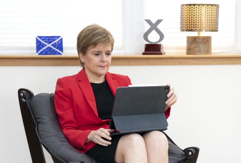 First Minister Nicola Sturgeon at her home in Glasgow preparing her speech she will give to the SNP National Conference virtually on Monday.