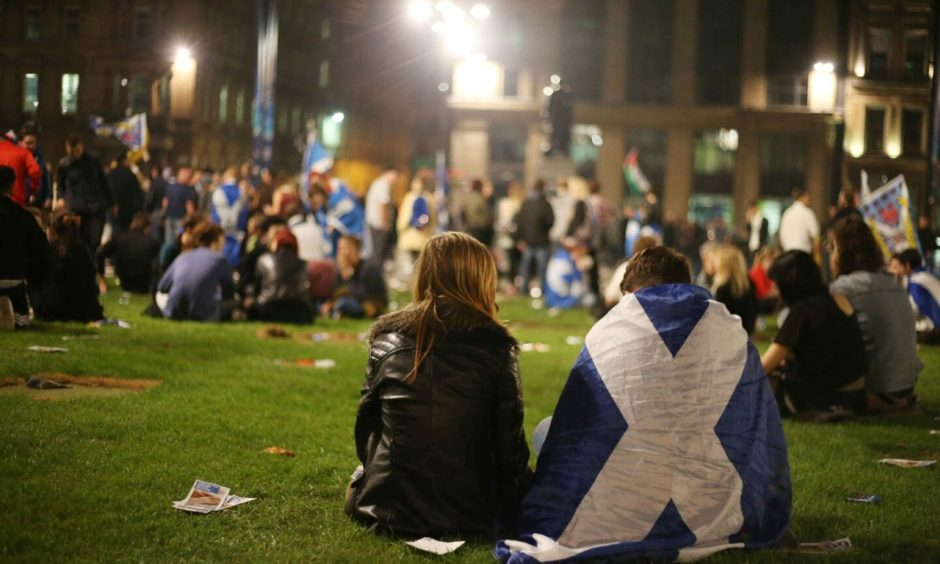 Yes campaign supporters in George Square, Glasgow, as ballet papers for the Scottish independence referendum are counted through the night.