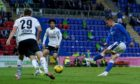 Glenn Middleton hits a shot in St Johnstone's second leg tie against LASK in the Europa Conference League qualifier at McDiarmid Park.