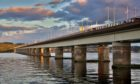 Courier Features - Vague information - Oor Wullie at Tay Bridge – possible magazine cover for issue about Tay Road Bridge anniversary. Picture shows; Tay Road Bridge and River Tay at dusk, Tuesday 09 August 2016.