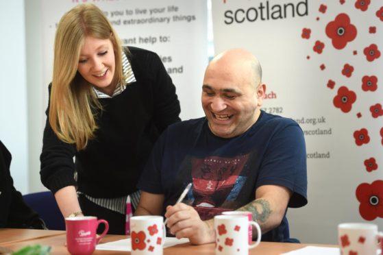 Poppyscotland staff member helps veteran