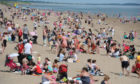 Sun seekers enjoy a balmy day in Broughty Ferry beach