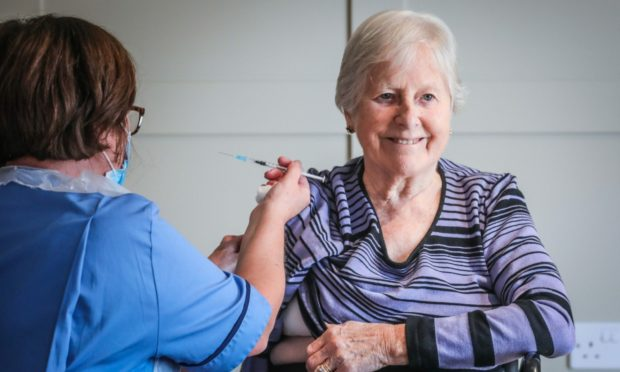 Perth care home resident Sheena Cargill receives her booster Covid jab.