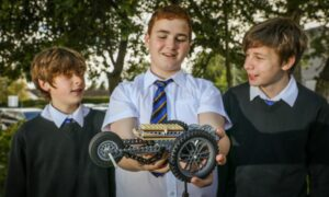 Ethan Mundy, Reuben Watkinson and Brodie Young with their model.