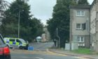 A man has been taken to hospital after being hit by a lorry in Perth